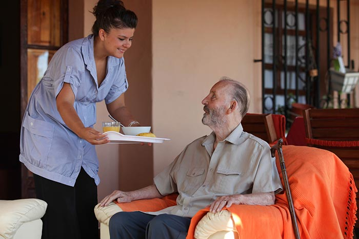 elderly veteran gentleman receiving domiciliary care at home